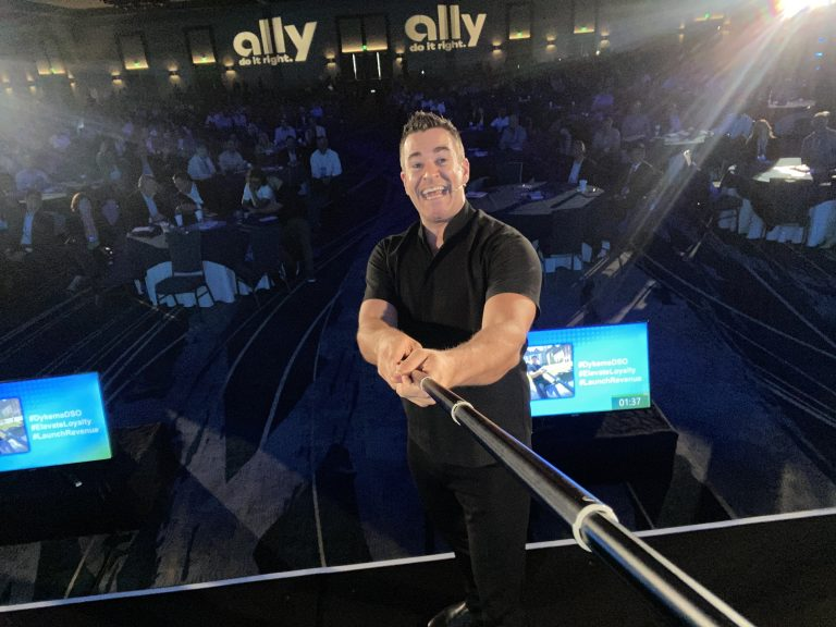 Professional Emcee Jeff Civillico takes picture of the audience with his selfie stick